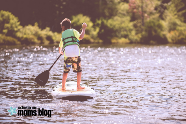 child paddleboarding