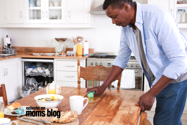 man cleaning in kitchen