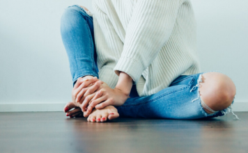 woman sitting in jeans & sweater